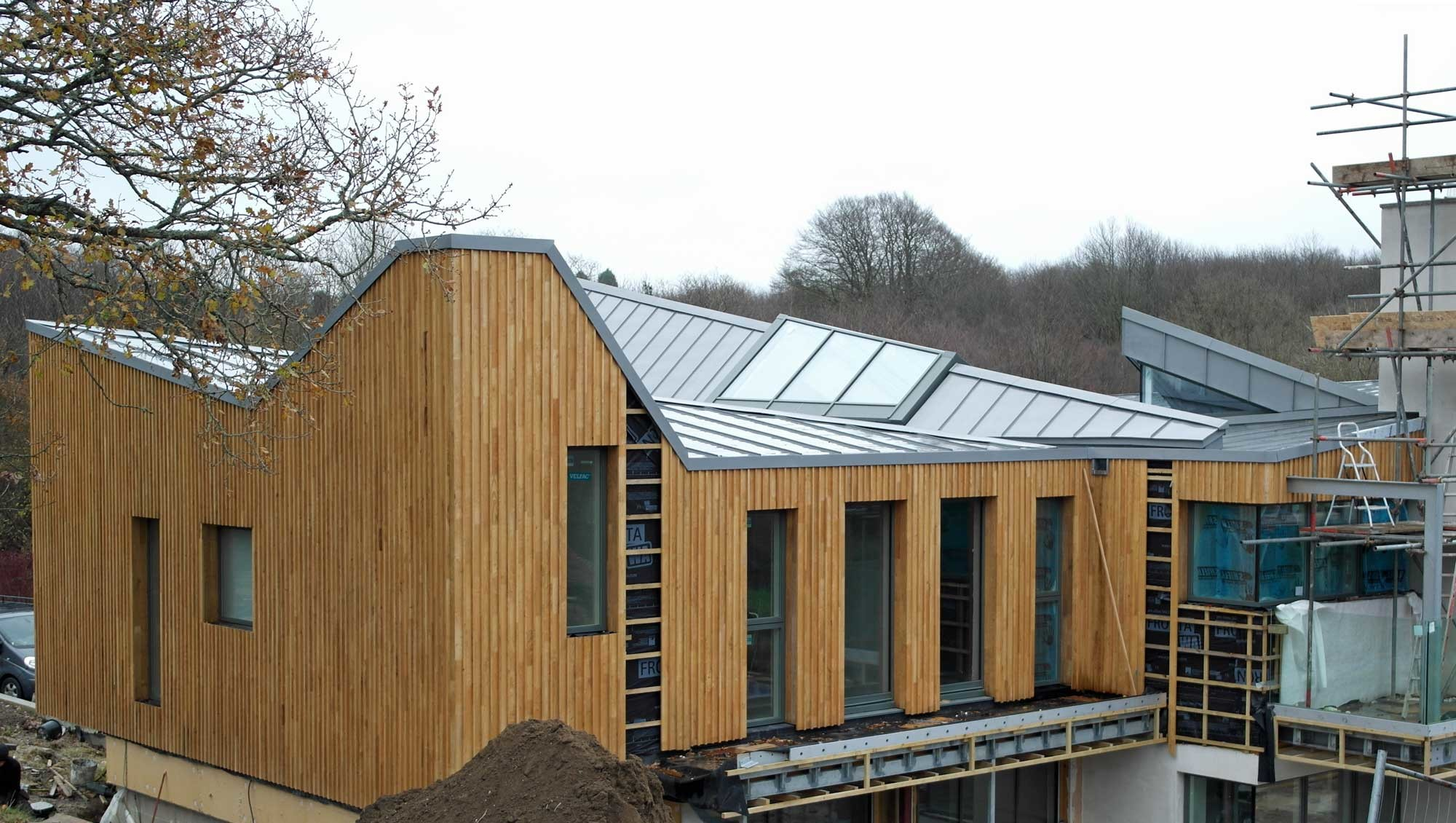 Modern new build design with large zinc roof in hadlow for Modern zinc houses