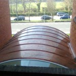 Curved copper porch in Brighton, Sussex carehome