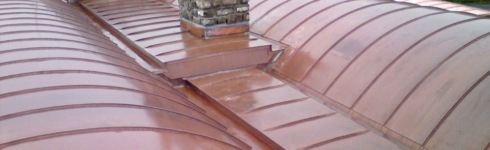 Curved barrel-vaulted copper roofs for barn