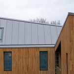 Modern new-build design with large zinc roof, i8n Hadlow Down, East Sussex
