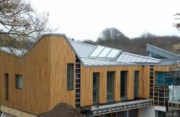 Modern new-build design with large zinc roof in Hadlow Down